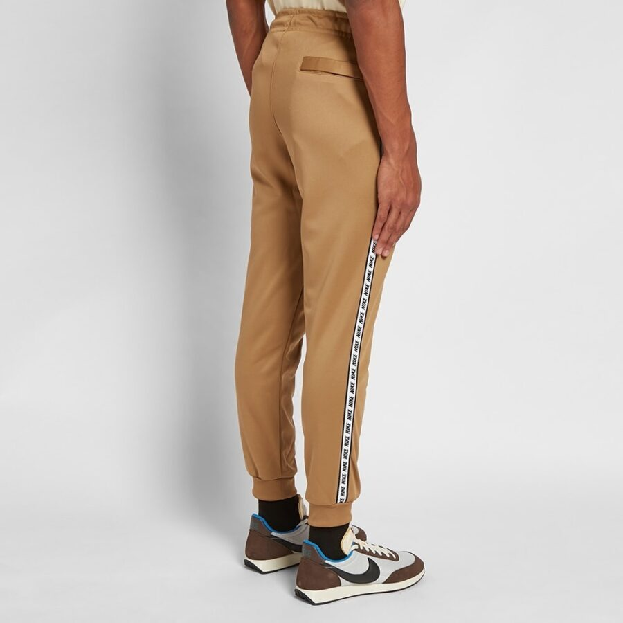 Nike Repeat Poly Trackpants in Beige and Black